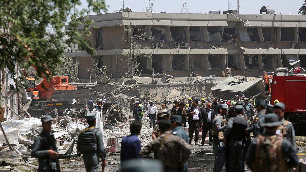 Security forces inspect the site of a suicide attack where German Embassy is located in Kabul, Afghanistan, Wednesday, May 31, 2017.
