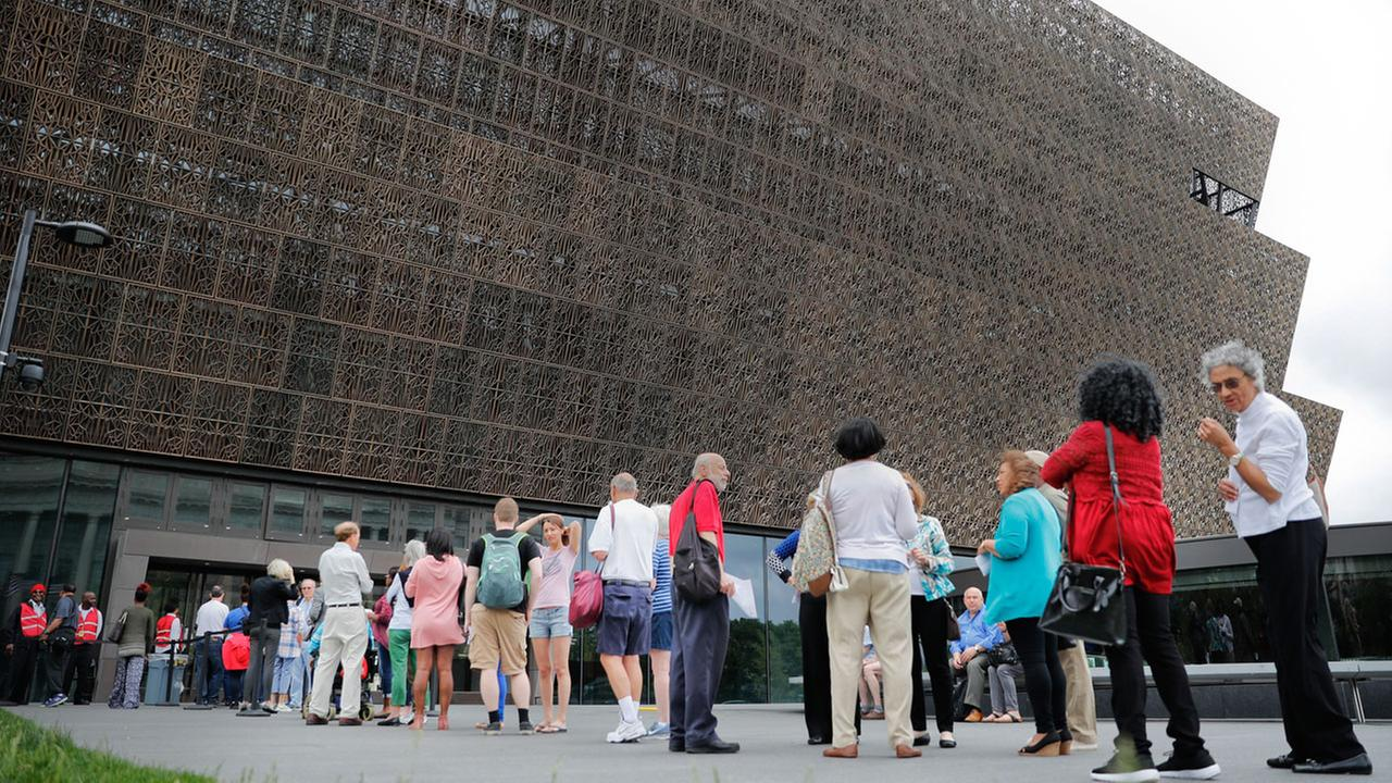 In this May 1, 2017, file photo, people wait in line to enter the Smithsonian National Museum of African American History and Cultural on the National Mall in Washington.