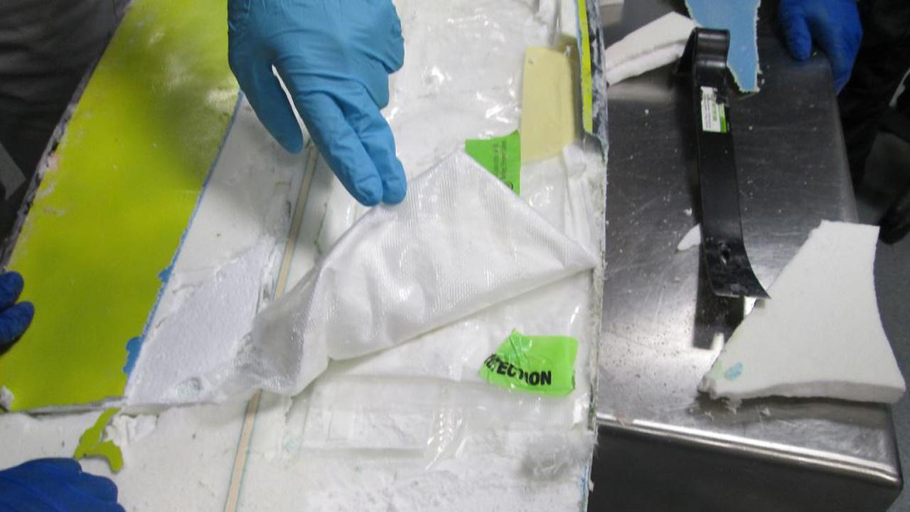 Bags of cocaine hidden in a hollowed-out surfboard are seen at LAX in February 2014. The man who tried to smuggle them was sentenced to prison in July 2014.