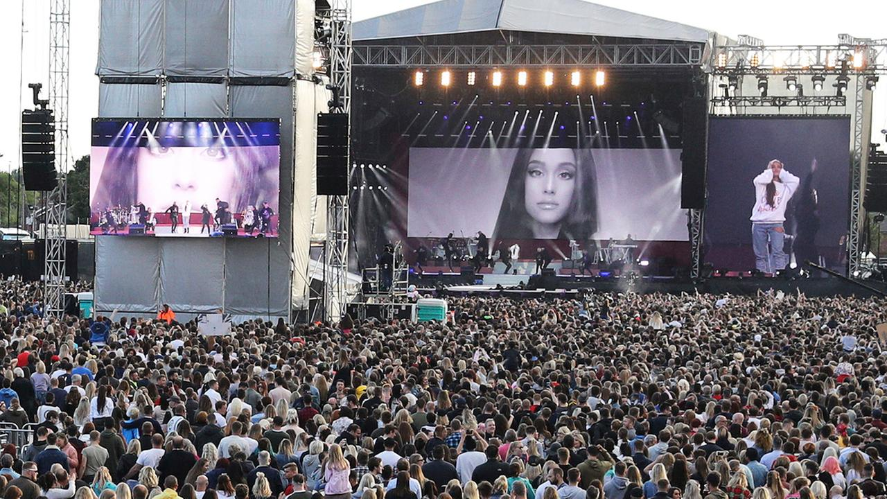 On this Sunday, June 4, 2017, handout photo provided by Owen Humphreys for One Love Manchester, Ariana Grande performs at the tribute concert in Manchester.