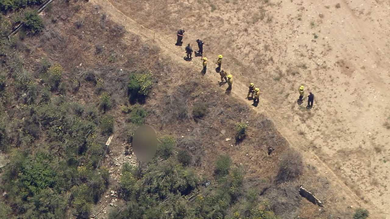 Emergency personnel respond to the Angeles National Forest, where a body was found off the side of Angeles Forest Highway at mile marker 24 on Monday, June 12, 2017.