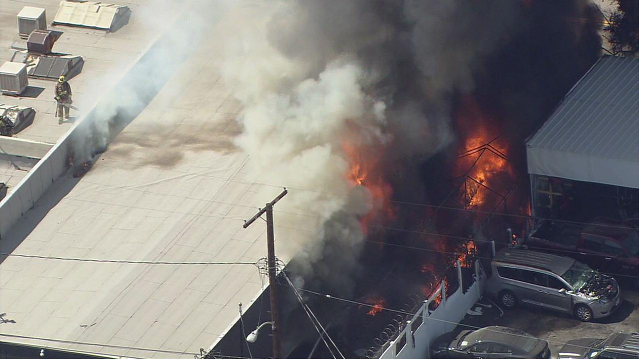 Flames erupted from inside a commercial building in Van Nuys on Tuesday. June 13, 2017.