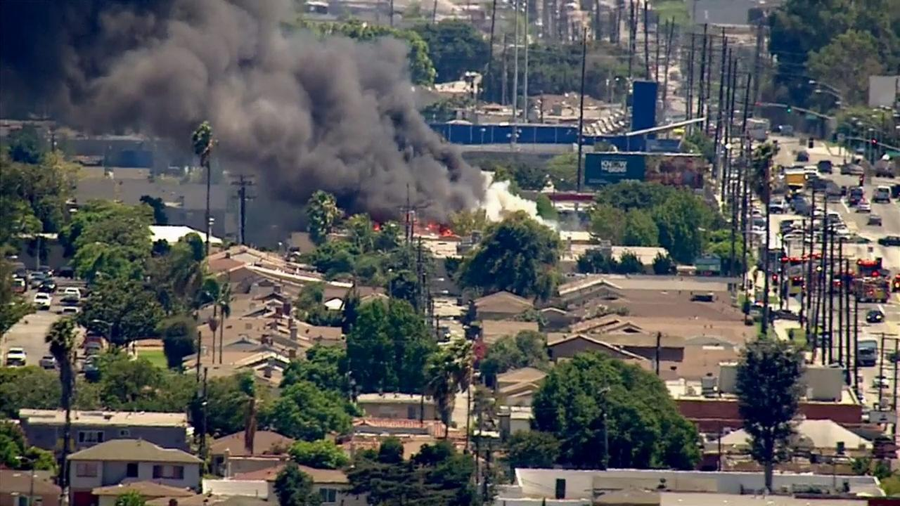 Smoke is seen from a fire at Animo South L.A. Charter High School on Tuesday, July 22, 2014.