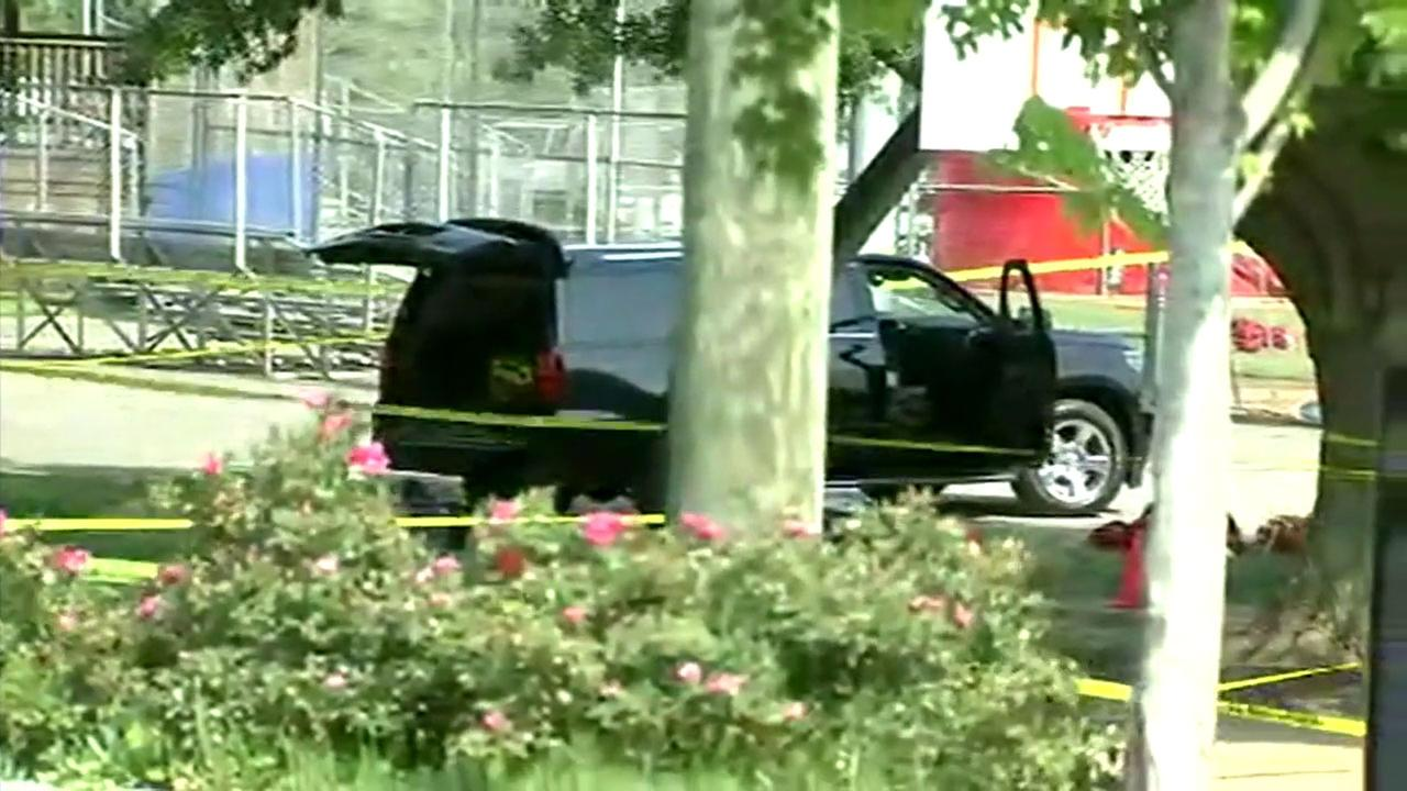 A bullet-riddled SUV remains at the scene of a gun battle in which a congressman and several staffers were wounded and the suspect was killed in Virginia.