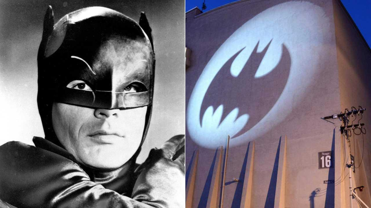 (Left) Actor Adam West is shown in costume on January 23, 1966. (Right) The Bat-Signal lights the side of Stage 16 at Warner Bros. on Aug. 18, 2014.