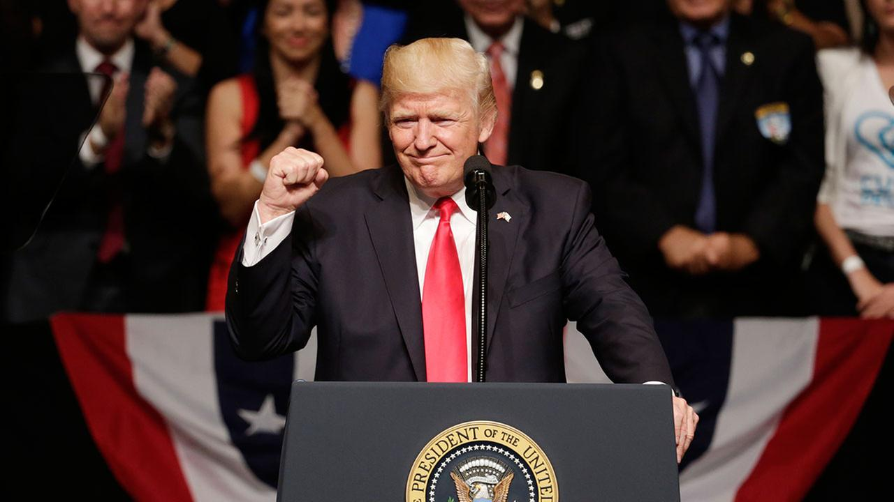 President Donald Trump gestures during a speech in Miami, Friday, June 16, 2017.