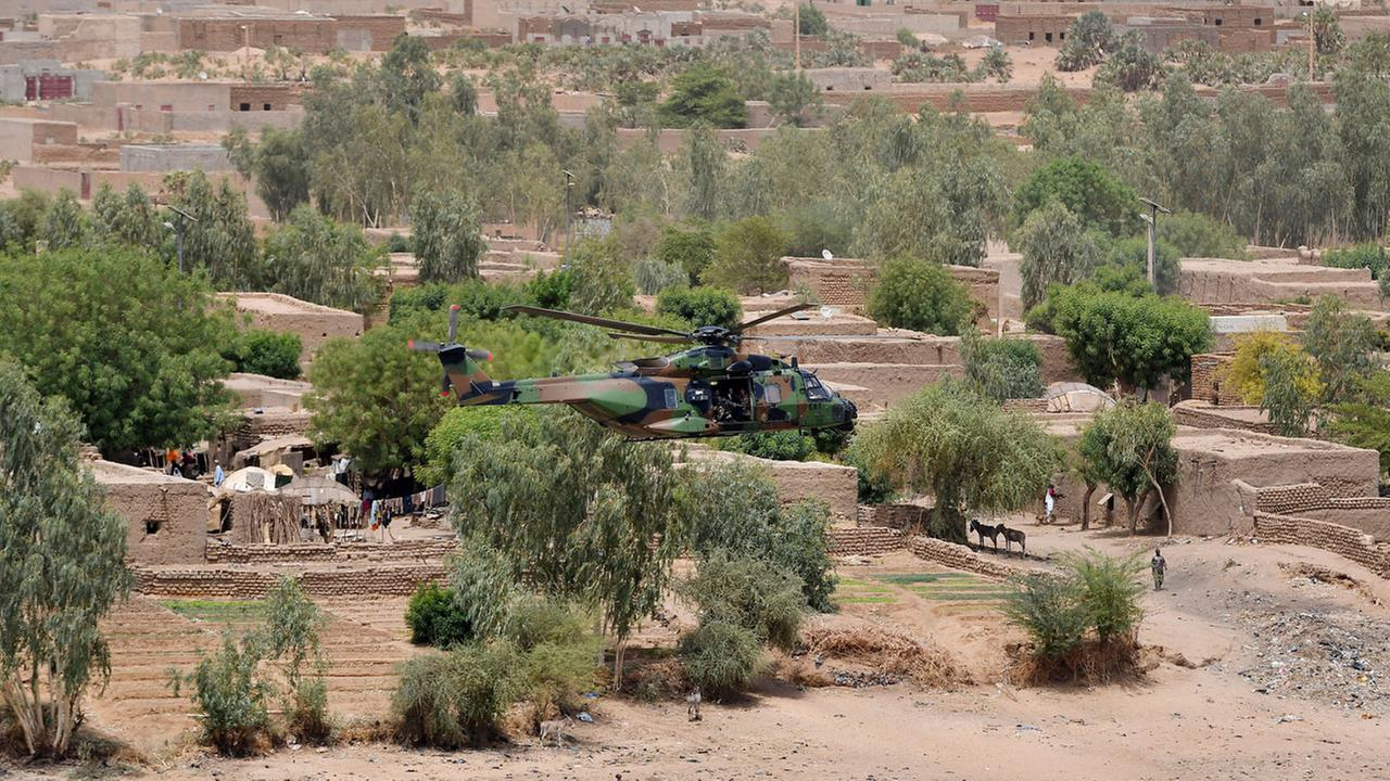 French President Emmanuel Macron flies over Gao in a military helicopter as he visits the troops of Operation Barkhane, Frances largest overseas military operation, in Mali.