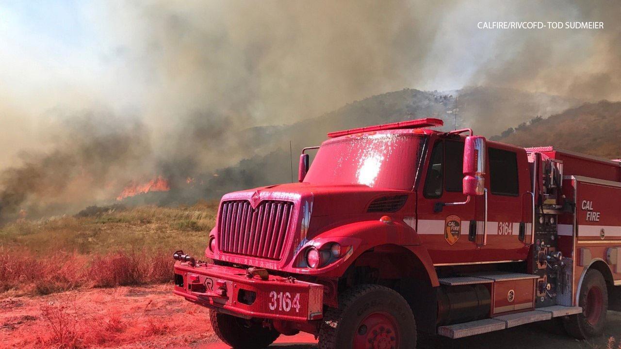 Over 200 firefighters battling brush fire near Moreno Valley