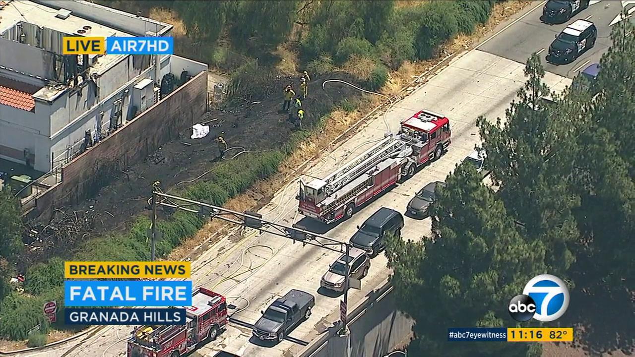 1 dead after vegetation fire erupts near gas station in Granada Hills