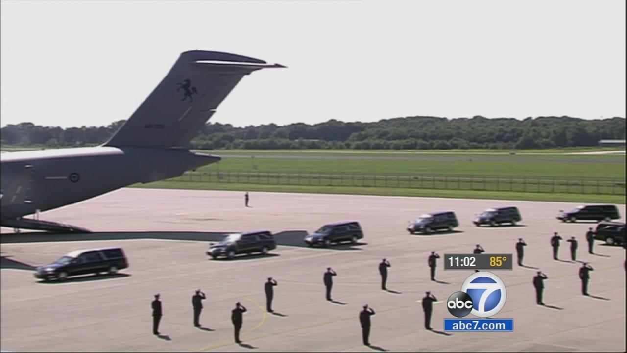 Two military transport planes carrying the bodies of some victims of the Malaysia Airlines Flight 17 crash arrived in the Netherlands on Wednesday, July 23, 2014.