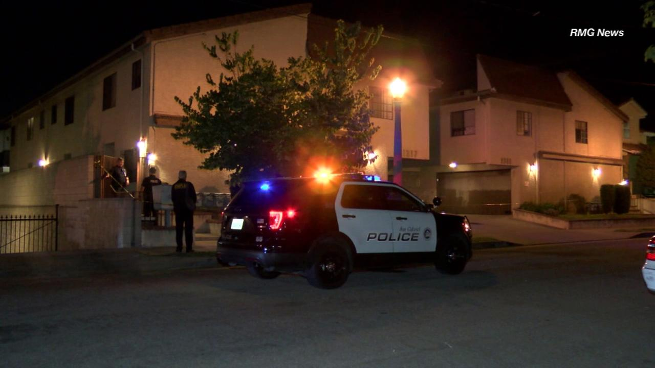 Police are seen outside an apartment building in San Gabriel after two people were found dead Saturday, June 25, 2017.
