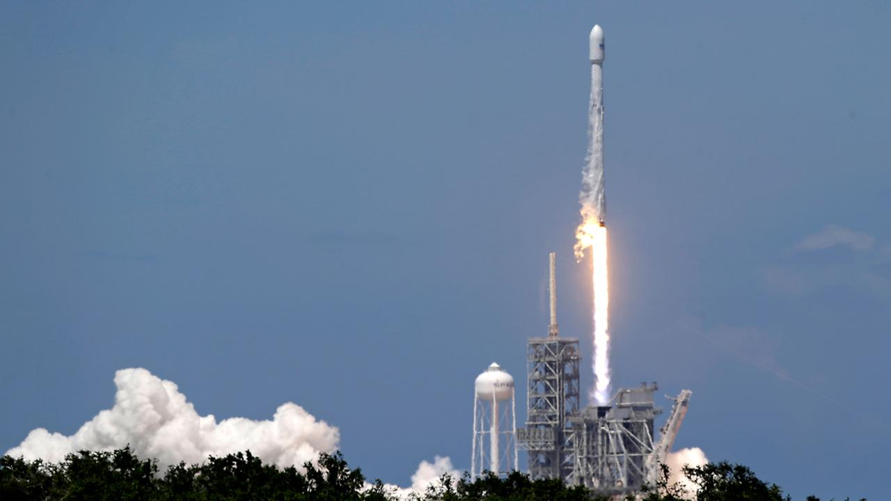 A Falcon 9 SpaceX rocket carrying a communications satellite that will provide television broadcast and data communications services over southeast Europe lifts off.