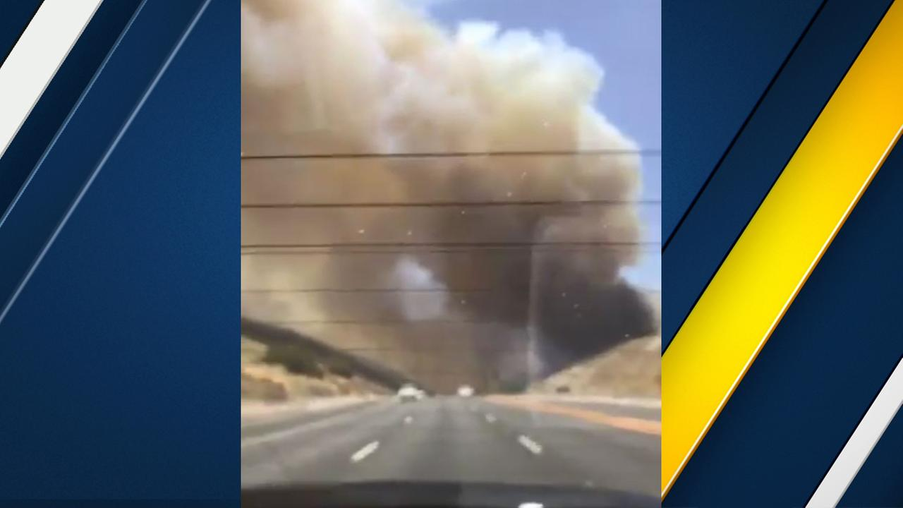 A massive plume of smoke rises above a brush fire in the Santa Clarita area on Sunday, June 25, 2017.