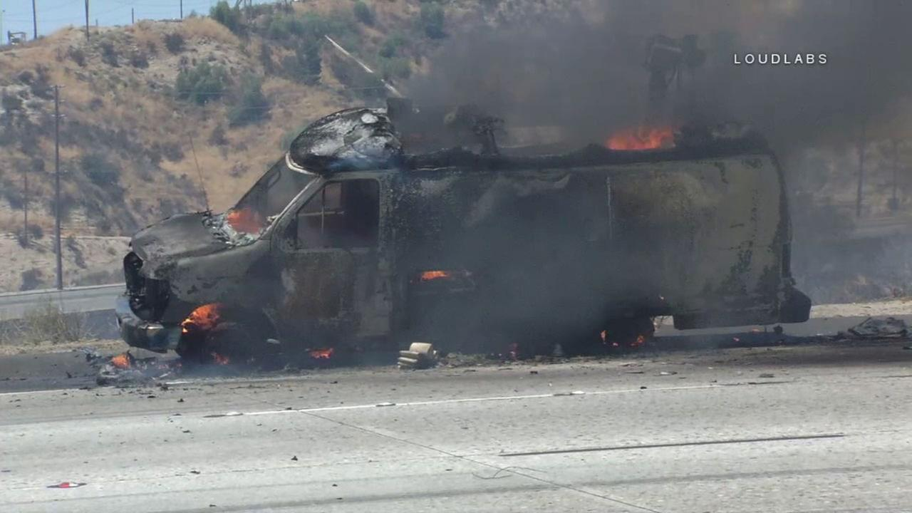 A local news van seen charred near a fast-moving brush fire in Santa Clarita on Sunday, June 25, 2017.