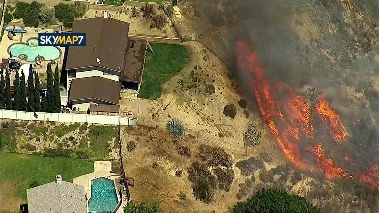 The Placerita Fire burns near the backyard of a home in Santa Clarita on Sunday, June 25, 2017.