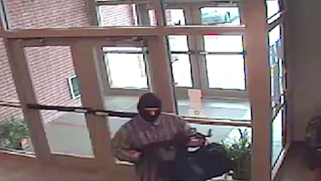 This undated image from surveillance video released by the FBI shows the bank robbery suspect known as the AK-47 Bandit.