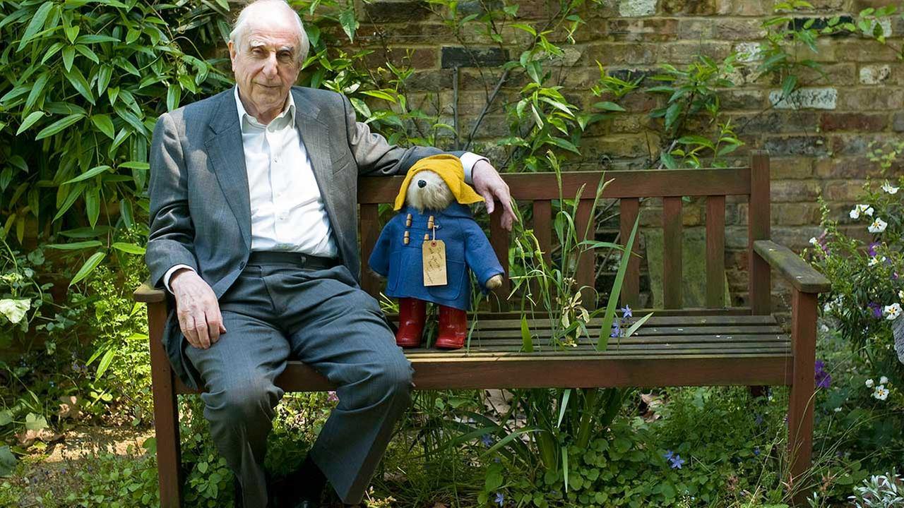 In this Thursday, June 5, 2008 file photo, British author Michael Bond sits with a Paddington Bear toy during an interview with The Associated Press in London.
