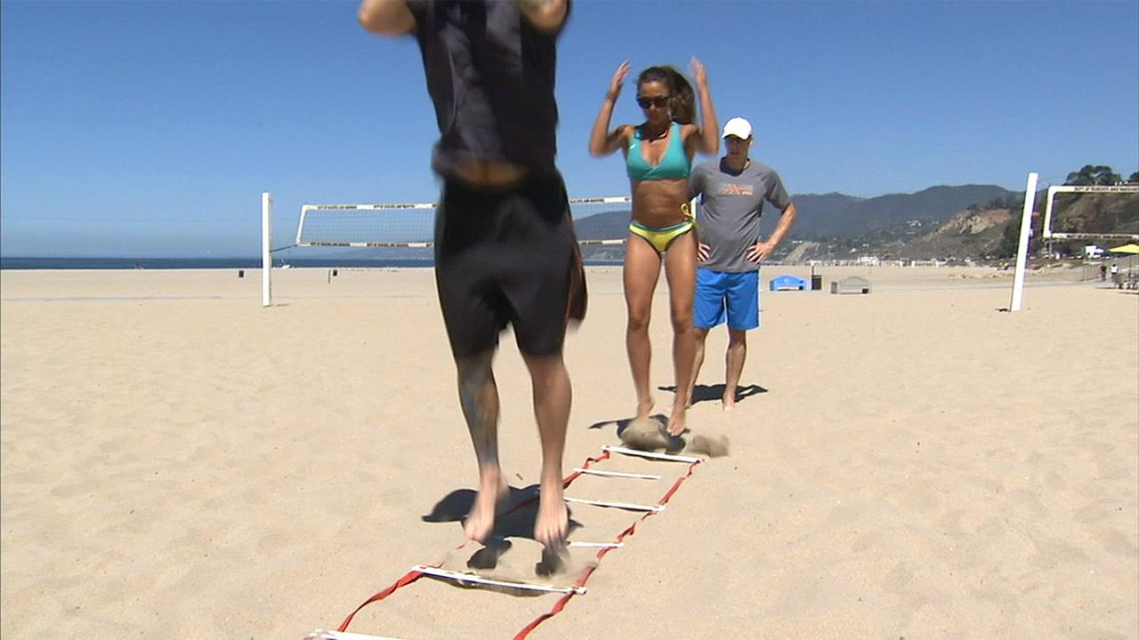 ASICS coach Michelle Lovitt leads a sand training session on Long Beach.