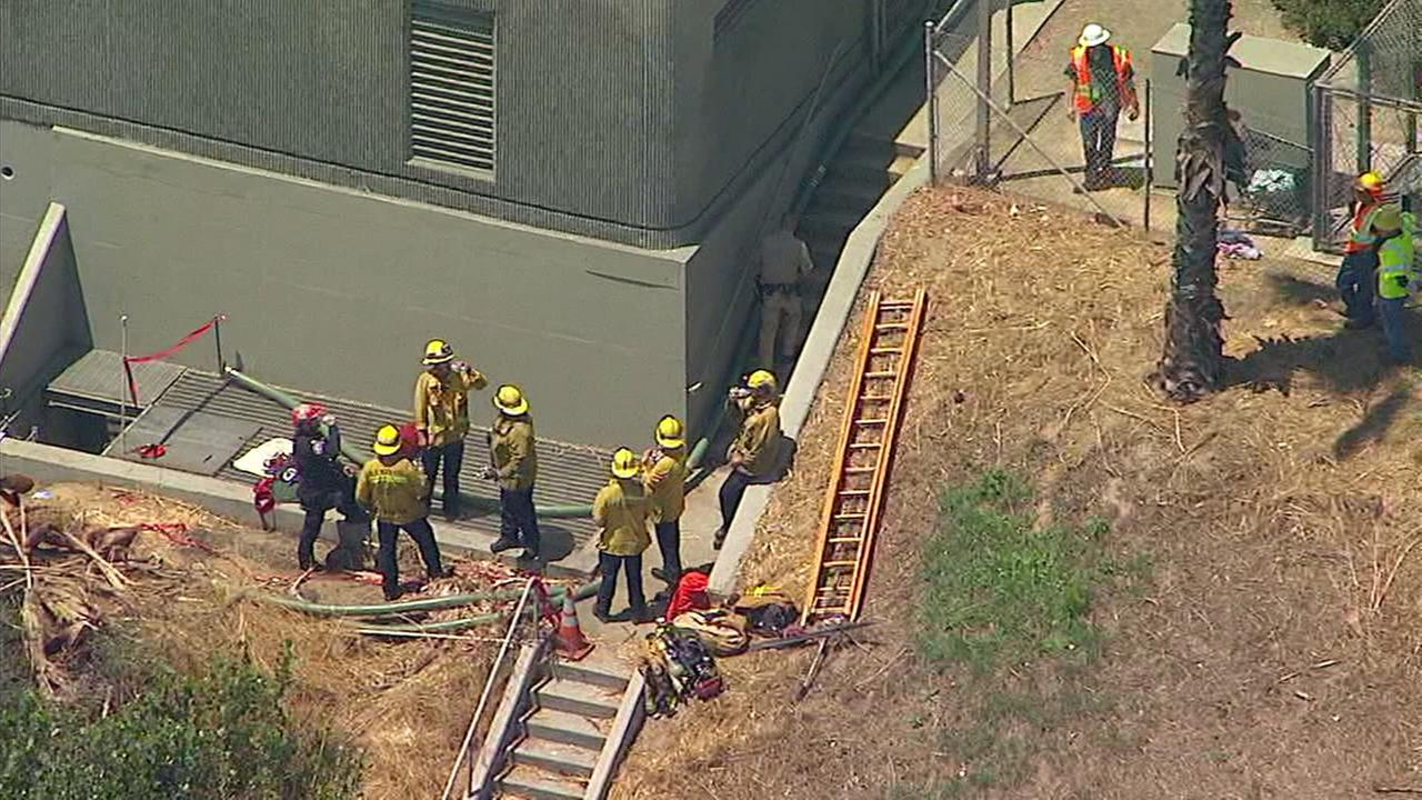 Los Angeles County firefighters conducted a search-and-rescue operation after a man said he was trapped in a tunnel under the 105 Freeway in Hawthorne.