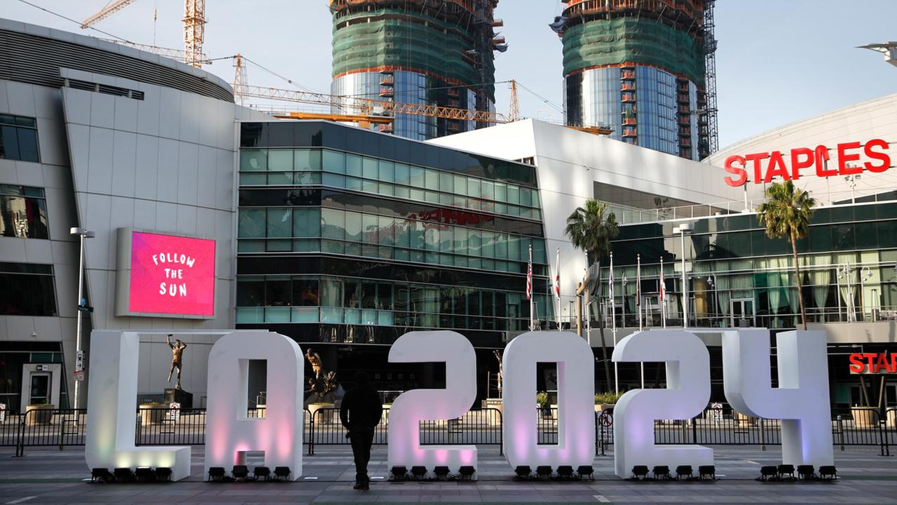 In this Thursday, May 11, 2017 file photo, a Los Angeles 2024 sign stands in front of Staples Center, in Los Angeles.