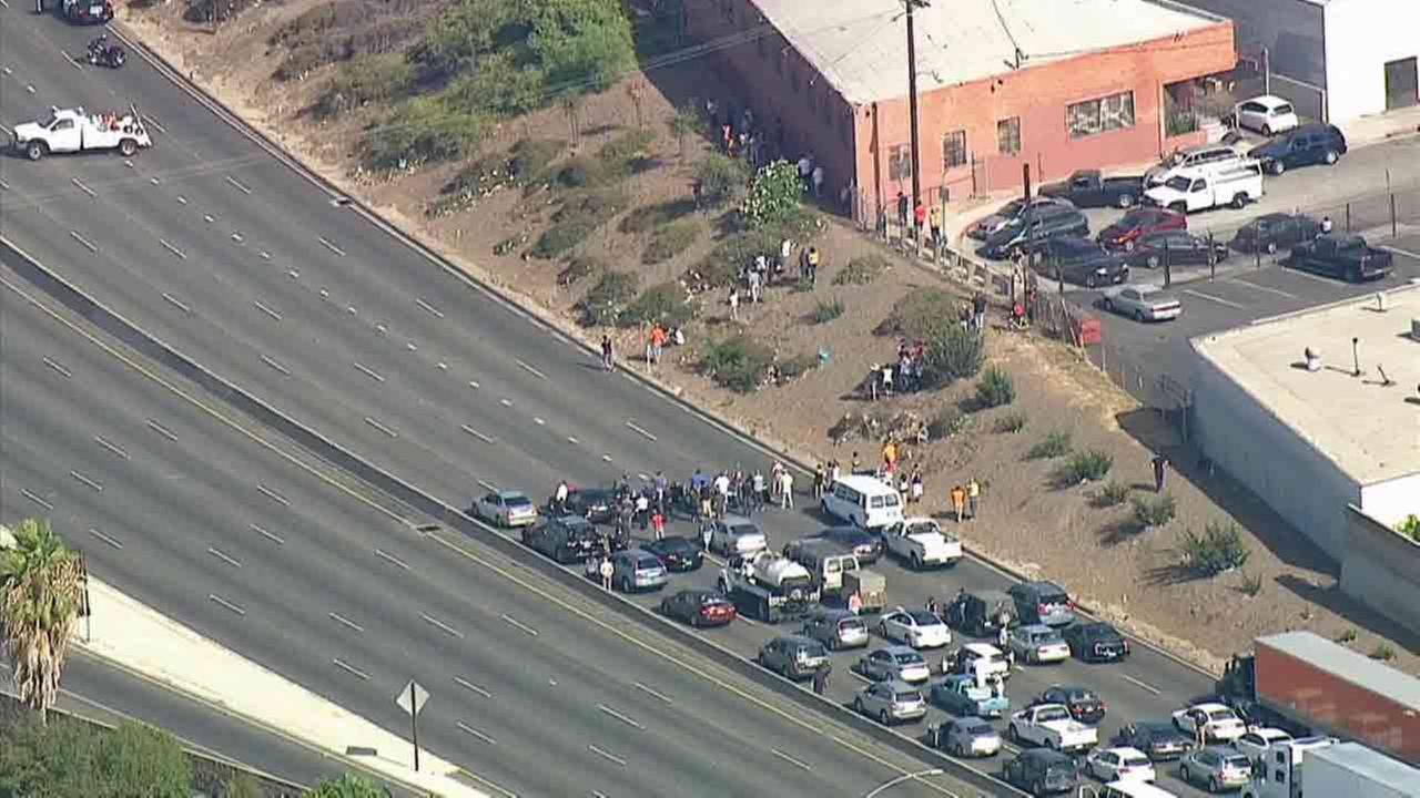 A man on an overpass caused the shutdown of all lanes of the 5 Freeway near Olympic Boulevard in East Los Angeles Friday July 25, 2014, causing major backups.