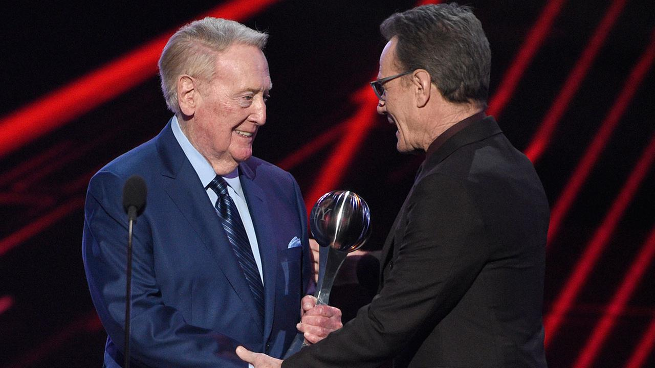 Vin Scully, left, accepts the Icon Award from Bryan Cranston at the ESPYS at the Microsoft Theater on Wednesday, July 12, 2017, in Los Angeles.