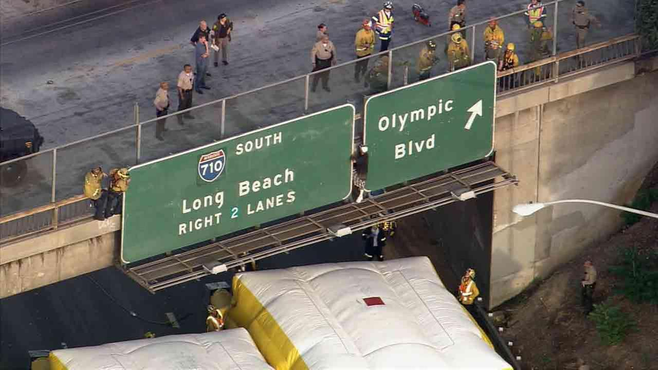 All lanes of the 5 Freeway were closed near Olympic Boulevard in East Los Angeles due to a man on an overpass July 25, 2014.