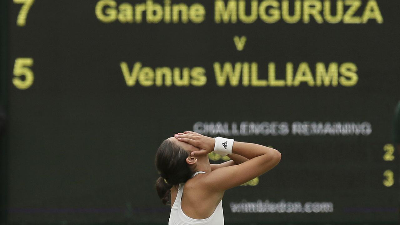 Spains Garbine Muguruza celebrates after beating Venus Williams to win the Womens Singles final match at the Wimbledon Tennis Championships in London Saturday, July 15, 2017.