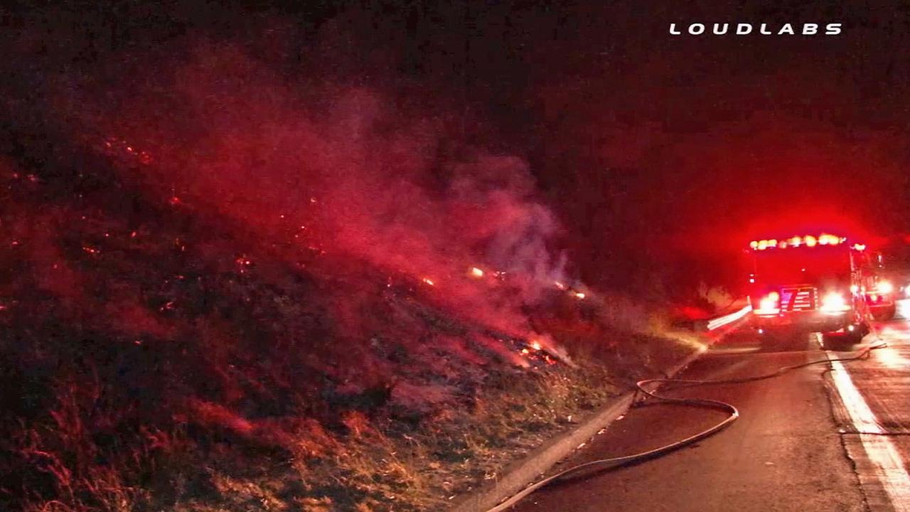 Firefighters at the scene of five brush fires that broke out off the 5 Freeway in Newhall on Saturday, July 26, 2014.