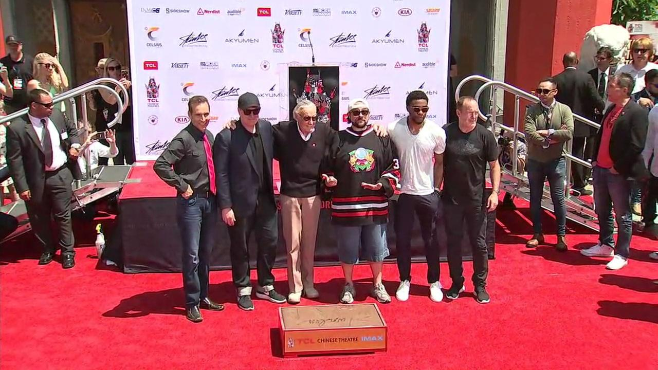 Tom McFarlane, Kevin Feige, Stan Lee, Kevin Smith, Chadwick Boseman and Clark Gregg take a photo during Lees hand and footprint ceremony on Tuesday, July 18, 2017.