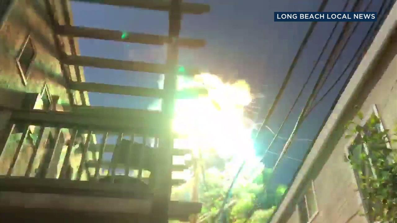 A balloon made contact with a power line between two homes in Long Beach, triggering a fiery explosion that knocked out electricity in a neighborhood for hours.
