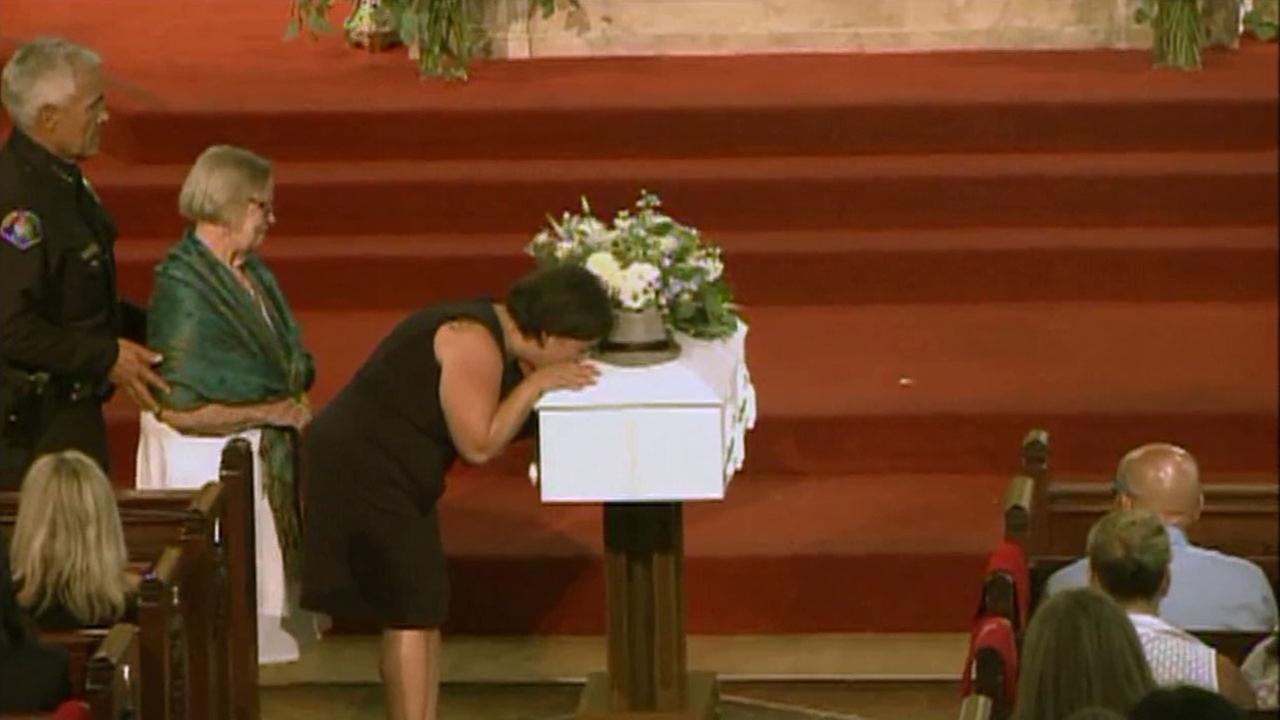 Ana Estevez kisses the coffin at the funeral of her son Aramazd Andressian Jr.