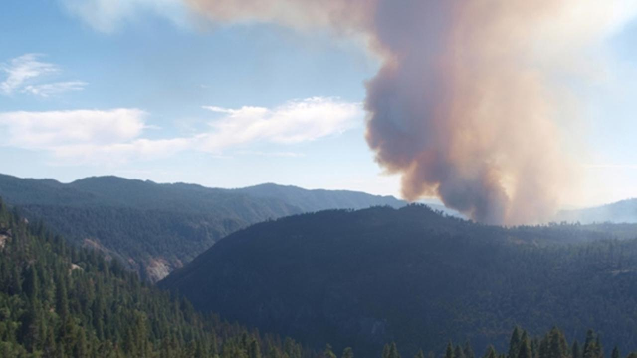 Turtleback Dome and Air Quality Webcam shows smoke from the wildfire burning near Yosemite National Park Saturday July 26, 2014. (National Park Service)