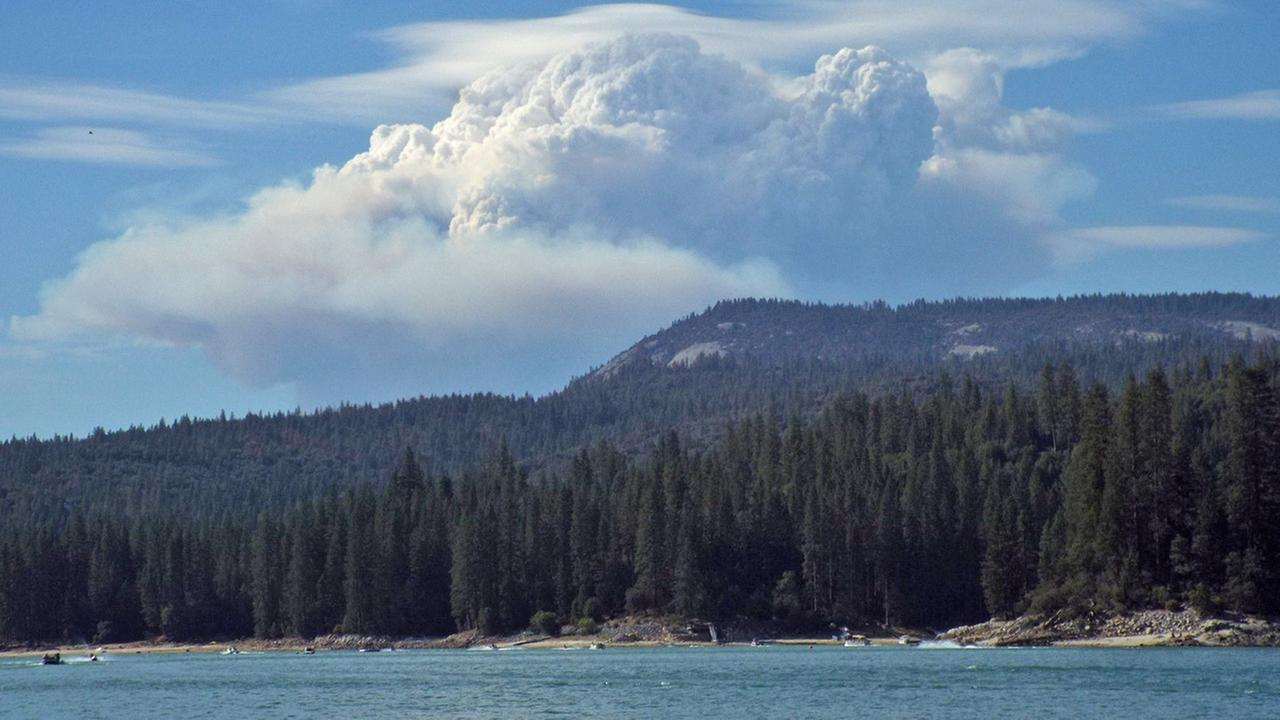 A wildfire is seen burning near Yosemite National Park Saturday July 26, 2014. Ruth