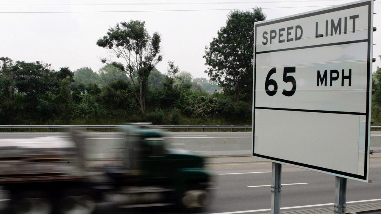 A truck rides past a speed limit sign Monday, July 25, 2005, on the Ohio Turnpike near Brecksville, Ohio.