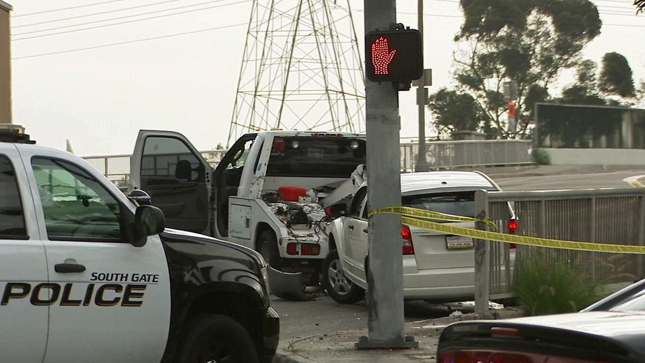 Police investigate a tow truck near the site of a shooting that left a man dead in South Gate on Sunday, July 27, 2014.