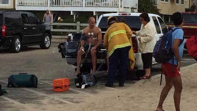 Emergency crews treat a scuba diver who was revived after being hit by lightning in Venice Beach on Sunday, July 27, 2014. <span class=meta>Venice 311</span>