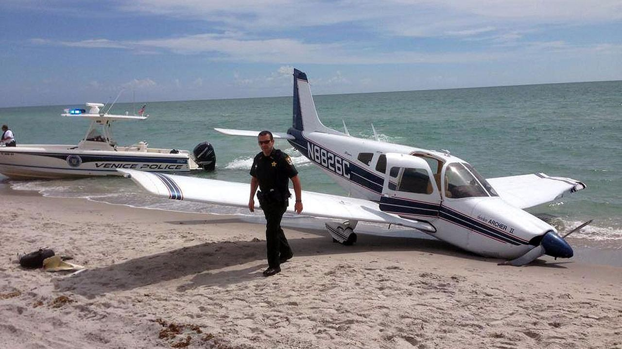 Emergency personnel are at the scene of a small plane crash in Caspersen Beach in Venice, Fla., Sunday, July 27, 2014.