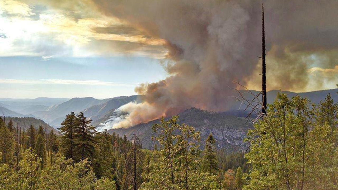 The El Portal Fire near Yosemite National Park sends smoke billowing into the air Sunday, July 27, 2014.
