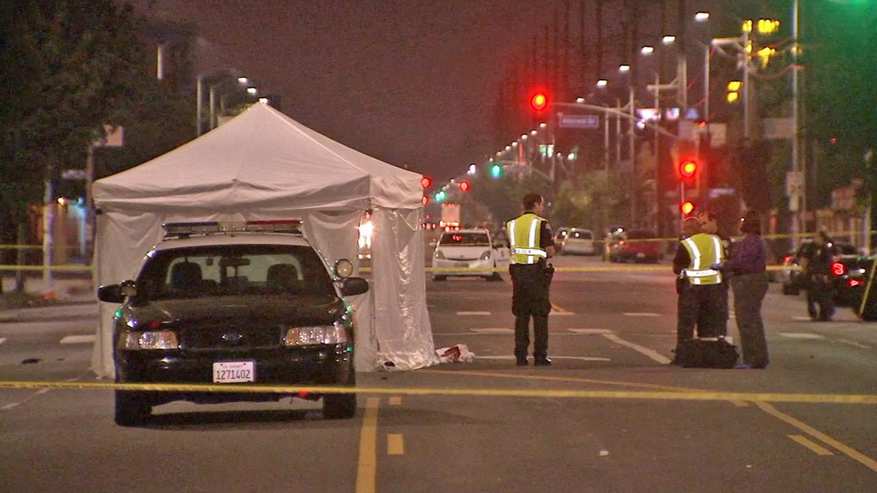 A tent shields the body of a pedestrian hit by an LAPD cruiser as authorities investigate the scene on Monday, July 28, 2014.