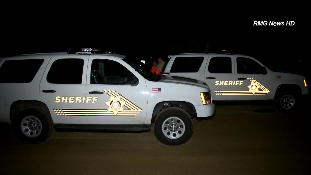 San Bernardino County Sheriffs vehicles are seen in Big Bear during a search for two missing horseback riders on Monday, July 28, 2014.