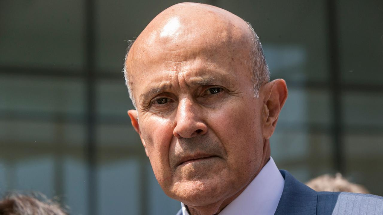 In this May 12, 2017, file photo, former L.A. County Sheriff Lee Baca leaves federal court after he was sentenced to three years in prison for obstructing an FBI investigation.