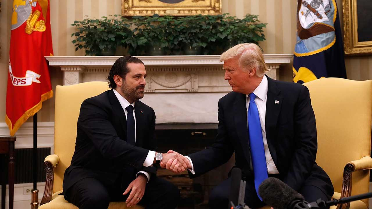 President Donald Trump shakes hands with Lebanese Prime Minister Saad Hariri during their meeting in the Oval Office of the White House in Washington, Tuesday, July 25, 2017.