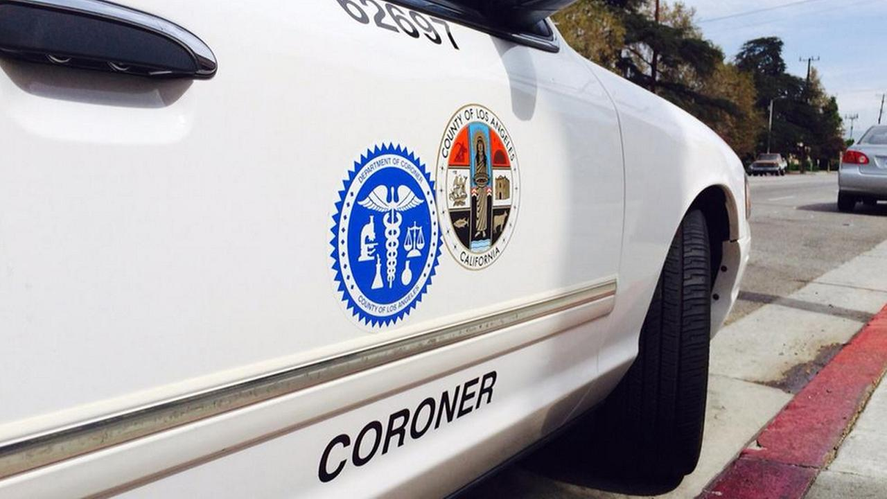 A vehicle for the Los Angeles County coroner is seen in Van Nuys Monday, July 28, 2014.