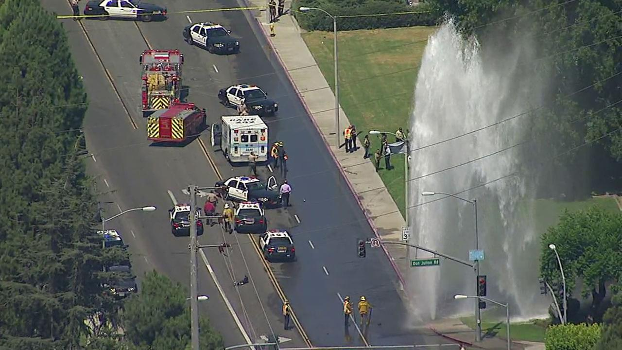 One person was killed in a shooting and car crash that sheared off a fire hydrant in the City of Industry, officials said.