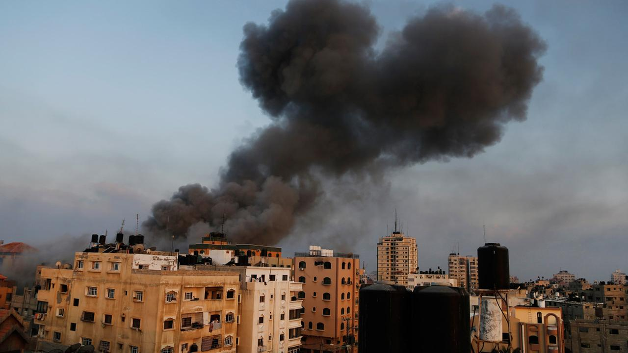 Smoke rises from the offices of the Hamas movements Al-Aqsa satellite TV station, in Gaza City, after it was hit and destroyed by an Israeli strike, Tuesday, July 29, 2014.