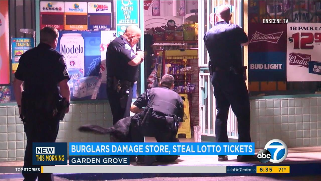 Officers and a police K-9 responded after burglars entered a Garden Grove store and stole an unspecified number of lottery tickets on Tuesday, Aug. 1, 2017.