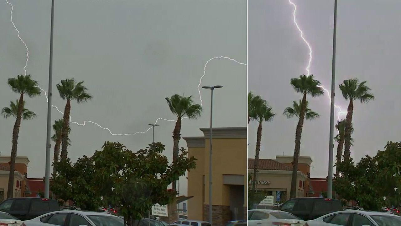 Two lightning strikes are seen in the skies from a shopping center in Upland on Tuesday, Aug. 1, 2017.