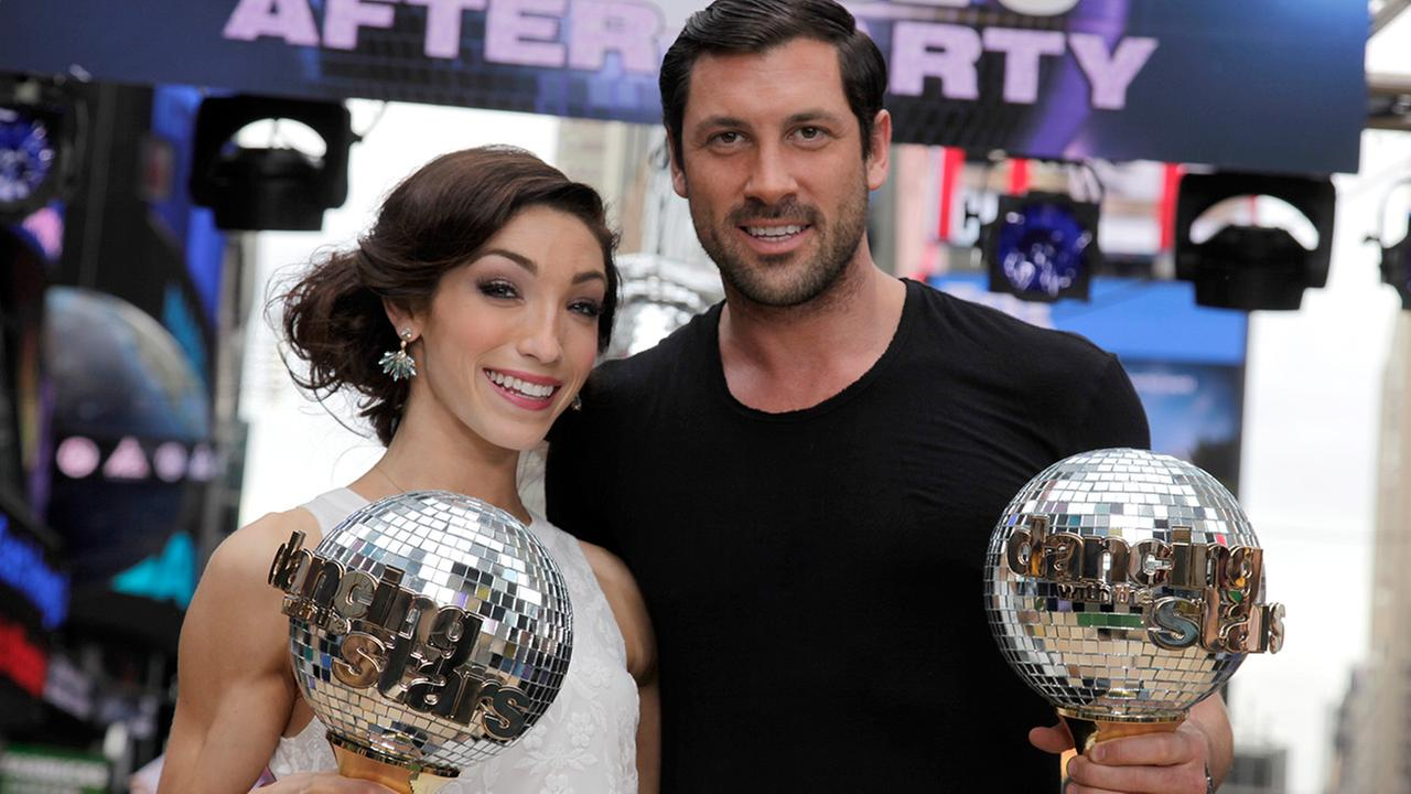 Olympic athlete Meryl Davis and dancer Maksim Chmerkovskiy, winners of Dancing with the Stars , appear on ABCs Good Morning America on Wednesday, May 21, 2014, in New York.