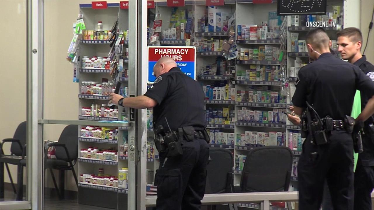 Police officers are seen outside a Simi Valley pharmacy after the business was burglarized on Wednesday, Aug. 2, 2017.